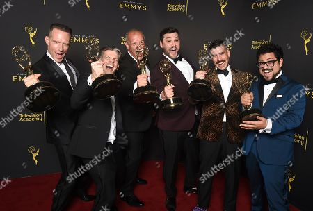 """Tony Zajkowski, Joseph DeShano, Iain Tibbles, Matthew Miller, Ryan Taylor, Carlos Gamarra. Tony Zajkowski, from left, Joseph DeShano, Iain Tibbles, Matthew Miller, Ryan Taylor and Carlos Gamarra winners of the award for outstanding picture editing for a structured reality or competition program for """"Queer Eye"""", pose for a portrait on night one of the Television Academy's 2019 Creative Arts Emmy Awards, at the Microsoft Theater in Los Angeles"""