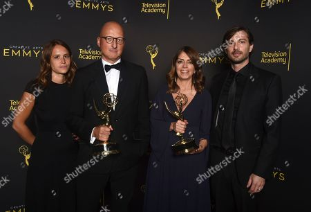 """Dan Reed, Nancy Abraham, James Safechuck. Dan Reed, from left, Nancy Abraham and James Safechuck pose with the award for outstanding documentary or nonfiction special for """"Leaving Neverland"""" on night one of the Television Academy's 2019 Creative Arts Emmy Awards, at the Microsoft Theater in Los Angeles"""