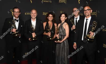 """Jonathan Cianfrani, Christopher Collins, Lydia Teneglia, Sandra Zweig, Jared Andrukanis, Michael Steed. Jonathan Cianfrani, from left, Christopher Collins, Lydia Teneglia, Sandra Zweig, Jared Andrukanis and Michael Steed, winners of the award for outstanding informational series or special for """"Anthony Bourdain: Parts Unknown"""" pose for a portrait on night one of the Television Academy's 2019 Creative Arts Emmy Awards, at the Microsoft Theater in Los Angeles"""