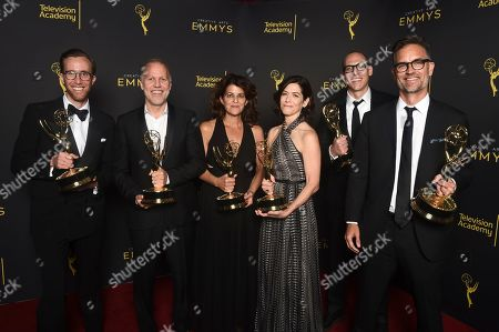 """Stock Photo of Jonathan Cianfrani, Christopher Collins, Lydia Teneglia, Sandra Zweig, Jared Andrukanis, Michael Steed. Jonathan Cianfrani, from left, Christopher Collins, Lydia Teneglia, Sandra Zweig, Jared Andrukanis and Michael Steed, winners of the award for outstanding informational series or special for """"Anthony Bourdain: Parts Unknown"""" pose for a portrait on night one of the Television Academy's 2019 Creative Arts Emmy Awards, at the Microsoft Theater in Los Angeles"""
