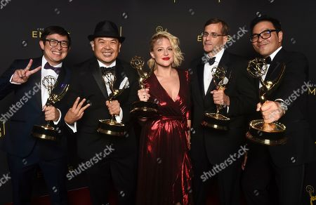 """Stock Image of Ken Kalopsis, from left, Bernie Su, Bonnie Buckner, Evan Mandery, and Michael Y. Chow winners of the award for outstanding innovation in interactive media for """"Artificial"""" pose for a portrait on night one of the Television Academy's 2019 Creative Arts Emmy Awards, at the Microsoft Theater in Los Angeles"""