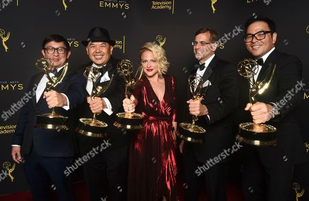 """Ken Kalopsis, from left, Bernie Su, Bonnie Buckner, Evean Mandery, and Michael Y. Chow winners of the award for outstanding innovation in interactive media for """"Artificial"""" pose for a portrait on night one of the Television Academy's 2019 Creative Arts Emmy Awards, at the Microsoft Theater in Los Angeles"""