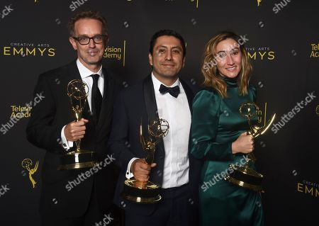 Stock Picture of Sam Bisbee, Rudy Valdez, Theodora Dunlap. Sam Bisbee, from left, Rudy Valdez and Theodora Dunlap, winners of the award for Outstanding Exceptional Merit In Documentary Filmmaking Award for 'The Sentence', pose for a portrait on night one of the Television Academy's 2019 Creative Arts Emmy Awards, at the Microsoft Theater in Los Angeles