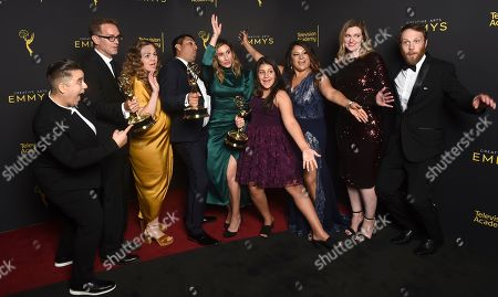 """Sam Bisbee, Jackie Kelman Bisbee, Rudy Valdez, Theodora Dunlap. The Team of """"The Sentence"""" pose with the award for exceptional merit in documentary filmmaking on night one of the Television Academy's 2019 Creative Arts Emmy Awards, at the Microsoft Theater in Los Angeles"""