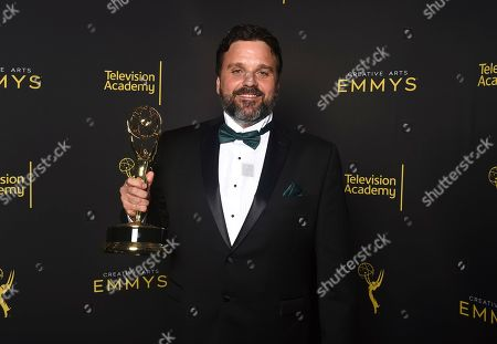 "Alessandro Soares, winner of the award for outstanding picture editing for an unstructured reality or competition program for ""United Shades of America with W. Kamau Bell"" poses for a portrait on night one of the Television Academy's 2019 Creative Arts Emmy Awards, at the Microsoft Theater in Los Angeles"