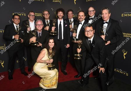 "Al Jean, John Frink, Ryan Koh, Richard Raynis, Tom Klein, Andrea Romero, Mike B. Anderson, Michael Price, Rob Oliver, Eddie Rosas, Carlton Batten. The team from ""The Simpsons"" poses with the award for outstanding animated program for ""Mad About the Toy"" on night one of the Television Academy's 2019 Creative Arts Emmy Awards, at the Microsoft Theater in Los Angeles"