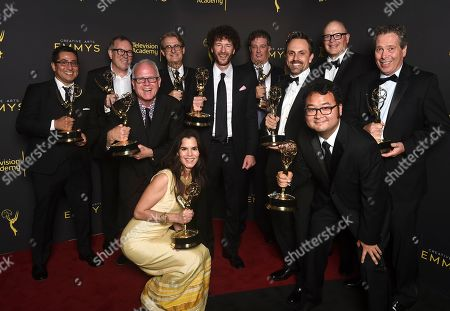 "Stock Picture of Al Jean, John Frink, Ryan Koh, Richard Raynis, Tom Klein, Andrea Romero, Mike B. Anderson, Michael Price, Rob Oliver, Eddie Rosas, Carlton Batten. The team from ""The Simpsons"" poses with the award for outstanding animated program for ""Mad About the Toy"" on night one of the Television Academy's 2019 Creative Arts Emmy Awards, at the Microsoft Theater in Los Angeles"