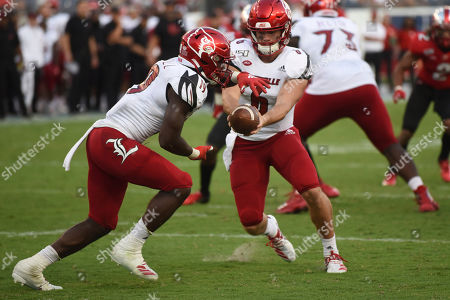 Evan Conley, Hassan Hall. Louisville quarterback Evan Conley (9) hands off to running back Hassan Hall (19) against Western Kentucky in the second half of an NCAA college football game, in Nashville, Tenn