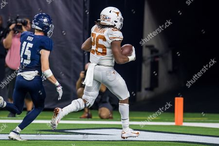 Texas Longhorns running back Keaontay Ingram (26) scores a touchdown in front of Rice Owls cornerback Andrew Bird (15) during the 3rd quarter of an NCAA football game between the Texas Longhorns and the Rice Owls at NRG Stadium in Houston, TX. Texas won the game 48 to 13