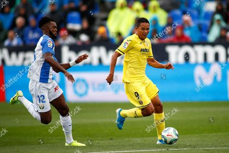 Stock Photo of Carlos Bacca of Villarreal and Chidozie Awaziem of Leganes