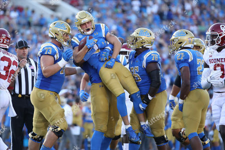 UCLA Bruins wide receiver Kyle Philips (2) gets a huge hug after scoring a touchdown during the game versus the Oklahoma Sooners and the UCLA Bruins at The Rose Bowl in Pasadena, CA. (Photo by Peter Joneleit)