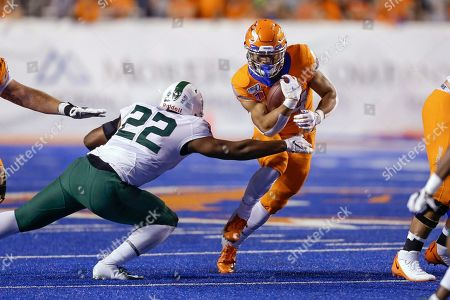 Boise State running back Robert Mahone (34) runs through an arm tackle attempt by Portland State defensive end James Thomas (22) during the first half of an NCAA college football game, in Boise, Idaho