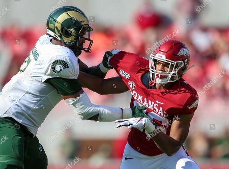 Stock Picture of Zach Williams #56 Arkansas defensive lineman works against Colorado State offensive lineman Keith Williams #77. Arkansas defeated Colorado State 55-34 in Fayetteville, AR, Richey Miller/CSM