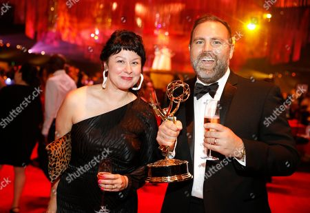 "Whitney Galitz Berger, David E.J. Berger. Whitney Galitz Berger, left, and David E.J. Berger, winner of the award for outstanding unstructured reality program for ""United Shades of America with W. Kamau Bell"", attend the Governors Ball during night one of the Television Academy's 2019 Creative Arts Emmy Awards, at the Microsoft Theater in Los Angeles"