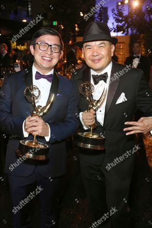 """Kevin Lin, Bernie Su. Kevin Lin, left, and Bernie Su with the award for outstanding innovation in interactive media for """"Wolves in the Walls: It's All Over,"""" attend the Governors Ball during night one of the Television Academy's 2019 Creative Arts Emmy Awards, at the Microsoft Theater in Los Angeles"""