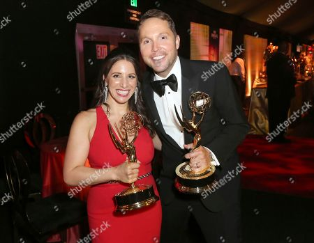 """Lauren Greenberg, Rob Crabbe. Lauren Greenberg, left, and Rob Crabbe, winners of the award for outstanding variety special (pre-recorded) for """"Carpool Karaoke: When Corden met McCartney Live From Liverpool,"""" attend the Governors Ball during night one of the Television Academy's 2019 Creative Arts Emmy Awards, at the Microsoft Theater in Los Angeles"""
