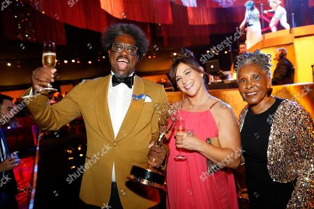 """W. Kamau Bell, Melissa Bell, Janet Cheatham Bell. W. Kamau Bell, from left, winner of the award for outstanding unstructured reality program for """"United Shades of America with W. Kamau Bell"""", Melissa Bell, and Janet Cheatham Bell attend the Governors Ball during night one of the Television Academy's 2019 Creative Arts Emmy Awards, at the Microsoft Theater in Los Angeles"""