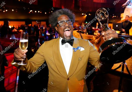 "W. Kamau Bell poses with his award for outstanding unstructured reality program for ""United Shades of America with W. Kamau Bell"" at the Governors Ball during night one of the Television Academy's 2019 Creative Arts Emmy Awards, at the Microsoft Theater in Los Angeles"