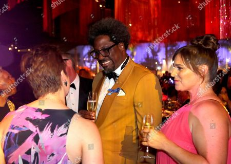W. Kamau Bell, center, attends the Governors Ball during night one of the Television Academy's 2019 Creative Arts Emmy Awards, at the Microsoft Theater in Los Angeles