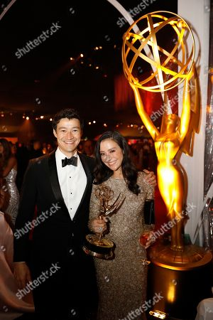 """Miklos Chai Vasarhelyi, Elizabeth Chai Vasarhelyi. Miklos Chai Vasarhelyi, left, and Elizabeth Chai Vasarhelyi, winner of the award for outstanding directing for a documentary/nonfiction program for """"Free Solo"""", attend the Governors Ball during night one of the Television Academy's 2019 Creative Arts Emmy Awards, at the Microsoft Theater in Los Angeles"""