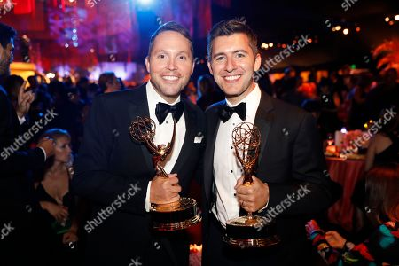 """Rob Crabbe, David Young. Rob Crabbe, left, and David Young pose with their awards for """"Carpool Karaoke"""" at the Governors Ball during night one of the Television Academy's 2019 Creative Arts Emmy Awards, at the Microsoft Theater in Los Angeles"""