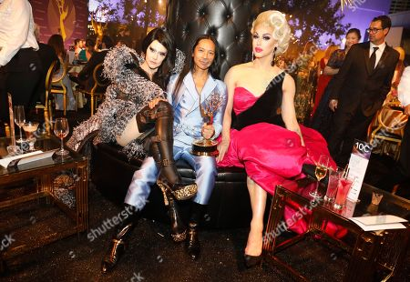 "Susanne Bartsch, Zaldy Goco, Brooke Lynn Hytes. Zaldy Goco, center, winner out of the award for outstanding costumes for variety, nonfiction or reality programming for ""RuPaul's Drag Race"" for 'Trump: the Rusical"", Susanne Bartsch, left, and Brooke Lynn Hytes, right, attend the Governors Ball during night one of the Television Academy's 2019 Creative Arts Emmy Awards, at the Microsoft Theater in Los Angeles"