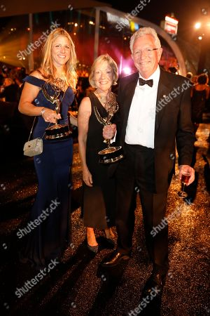 "Sophie Lanfear, Liz Scholey, Keith Scholey. Sophie Lanfear, from left, Keith Scholey, right, pose with their awards for outstanding documentary or nonfiction series for ""Our Planet"", and Liz Scholey at the Governors Ball during night one of the Television Academy's 2019 Creative Arts Emmy Awards, at the Microsoft Theater in Los Angeles"