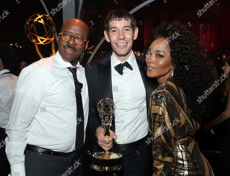 "Stock Picture of Courtney B. Vance, Angela Bassett, Alex Honnold. Courtney B. Vance, left, and Angela Bassett, right, pose with Alex Honnold, of ""Free Solo,"" at the Governors Ball during night one of the Television Academy's 2019 Creative Arts Emmy Awards, at the Microsoft Theater in Los Angeles"