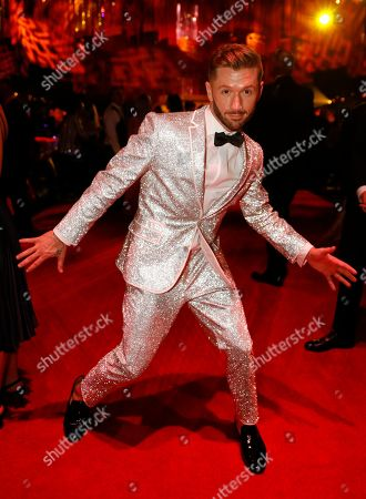 Stock Image of Travis Wall attends the Governors Ball during night one of the Television Academy's 2019 Creative Arts Emmy Awards, at the Microsoft Theater in Los Angeles