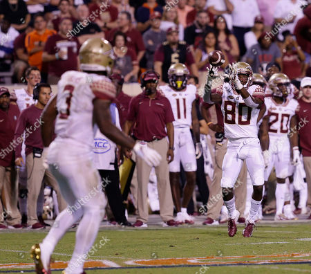 Florida State Seminoles WR #80 Ontaria Wilson catches a pass from Florida State Seminoles RB #3 Cam Akers during NCAA football game between the University of Virginia Cavaliers and the Florida State Seminoles at Scott Stadium in Charlottesville, Virginia