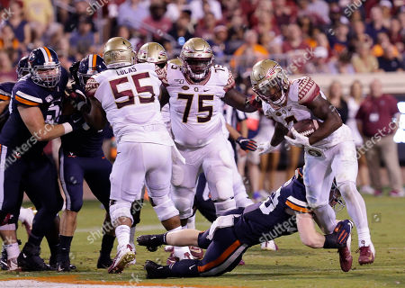 Florida State Seminoles RB #3 Cam Akers slips a tackle during NCAA football game between the University of Virginia Cavaliers and the Florida State Seminoles at Scott Stadium in Charlottesville, Virginia