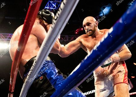 Tyson Fury of Britain (R) in action against Otto Wallin (L) of Sweden during their the lineal heavyweight championship and ceremonial WBC Mayan belt fight at the T-Mobile Arena in Las Vegas, Nevada, USA, 14 September 2019.
