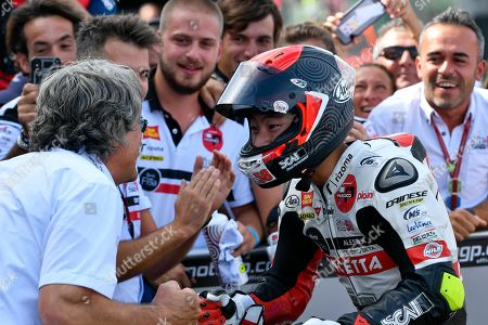 Stock Picture of Japanese Moto3 rider Tatsuki Suzuki (R) of the SIC58 Squadre Corse team celebrates with team owner Paolo Simoncelli after winning the Motorcycling Grand Prix of San Marino and Riviera di Rimini at the Misano Circuit in Santa Monica-Cella, northern Italy, 15 September 2019.