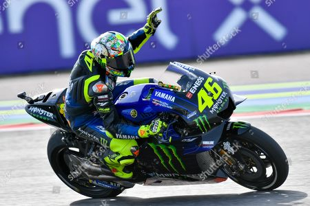 Italian MotoGP rider Valentino Rossi of Yamaha Factory Racing waves to fans during the warm-up before the Motorcycling Grand Prix of San Marino and Riviera di Rimini at the Misano Circuit in Santa Monica-Cella, northern Italy, 15 September 2019.