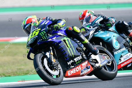 Italian MotoGP rider, number 21, Franco Morbidelli, of the Petronas Yamaha SRT and Italian MotoGP rider, number 46 Valentino Rossi, of the Yamaha Factory Racing during the sunday MotoGP Race of the Motorcycling Grand Prix of San Marino and Riviera di Rimini at the Misano Circuit in Misano Adriatico, Italy, 15 September 2019.