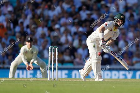 Stock Picture of Australia's Matthew Wade plays a shot off the bowling of England's Stuart Broad during the fourth day of the fifth Ashes test match between England and Australia at the Oval cricket ground in London