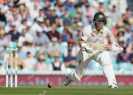 Australia's David Warner plays a shot off the bowling of England's Stuart Broad during the fourth day of the fifth Ashes test match between England and Australia at the Oval cricket ground in London
