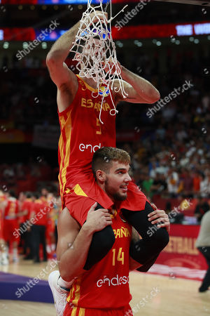 Rudy Fernandez (top) and Willy Hernandez Geuer of Spain celebrate winning against Argentina in the FIBA Basketball World Cup 2019 final match in Beijing, China, 15 September 2019.
