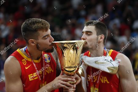 Stock Picture of Willy Hernangomez Geuer (L) and Juancho Hernangomez of Spain celebrate with the World Cup trophy following their win against Argentina in the FIBA Basketball World Cup 2019 final match in Beijing, China, 15 September 2019.