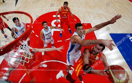 Rudy Fernandez (R) of Spain in action against Luis Scola (2-R) of Argentina during FIBA Basketball World Cup 2019 final match between Argentina and Spain in Beijing, China, 15 September 2019.