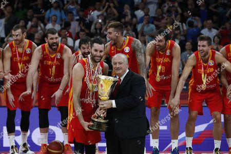 Spain's Rudy Fernandez (L) receives the World Cup trophy from Horacio Muratore (R), President of FIBA following their win against Argentina in the FIBA Basketball World Cup 2019 final match in Beijing, China, 15 September 2019.