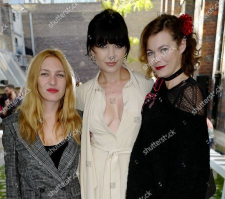 Stock Photo of Josephine De La Baume, Daisy Low and Jasmine Guinness in the front row