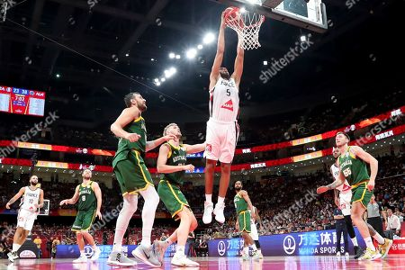 France's Nicolas Batum (C) dunks the ball during the third place match against Australia at the FIBA Basketball World Cup 2019, in Beijing, China, 15 September 2019.