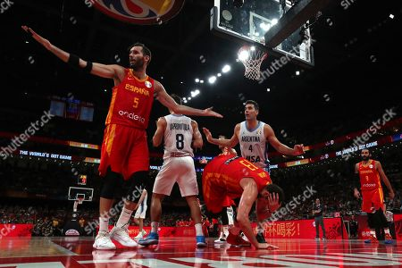 Spain's Marc Gasol center tumbles as teammate Rudy Fernandez at left and Argentina's Luis Scola, center in white react during the final of the FIBA Basketball World Cup held at the Cadillac Arena in Beijing, Sunday, Sept. 15, 2019.