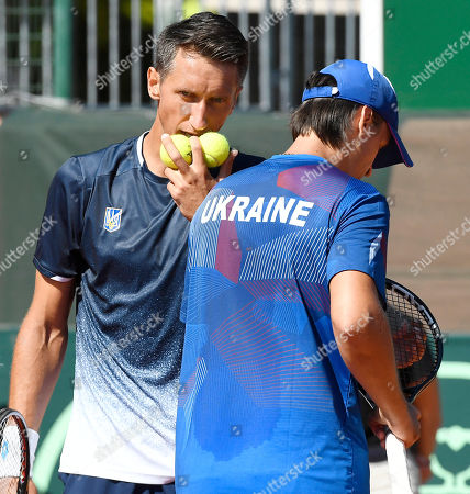 Denys Molchanov (R) and Sergiy Stakhovsky (L) of Ukraine react during their match against Attila Balazs and Marton Fucsovics of Hungary in rubber 3 of tennis Davis Cup Group I, Europe/Africa 1st round tie Hungary vs Ukraine in Budapest, Hungary, 15 September 2019.