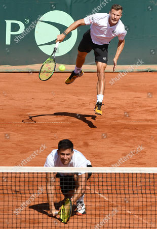 Marton Fucsovics (rear) and Attila Balazs of Hungary in action during their match against 