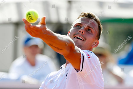 Stock Photo of Marton Fucsovics of Hungary plays against Sergiy Stakhovsky of Ukraine in rubber 4 of tennis Davis Cup Group I, Europe/Africa 1st round match Hungary vs. Ukraine in Budapest, Hungary, 15 September 2019.