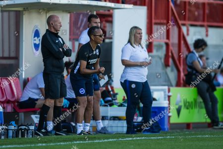 Stock Picture of Hope Powell, Manager of Brighton & Hove Albion FC & Emma Hayes, Manager of Chelsea FC on the sidelines during the FA Women's Super League match between Brighton and Hove Albion Women and Chelsea at The People's Pension Stadium, Crawley