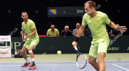 Mirza Basic (R) and Tomislav Brkic (L) of Bosnia in action during their double match against Jiri Lehecka and Jiri Vesely of Czech Republic at the Davis Cup Europe/Africa Group I first round tie between Bosnia and Czech Republic in Zenica, Bosnia and Herzegovina, 15 September 2019.