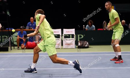 Mirza Basic (L) and Tomislav Brkic (R) of Bosnia in action during their double match against Jiri Lehecka and Jiri Vesely of Czech Republic at the Davis Cup Europe/Africa Group I first round tie between Bosnia and Czech Republic in Zenica, Bosnia and Herzegovina, 15 September 2019.